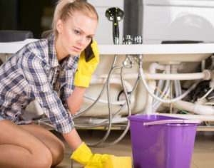 girl calling plumber after problems with plumbing overflow and inability to fix on her own in phoenix az