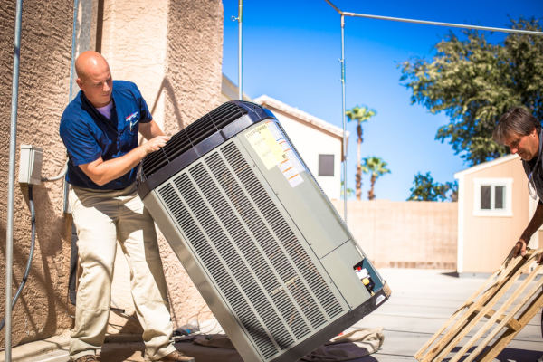Arizona heating and cooling specialist mike gibson uses pallet to unload new heat pump during installation services in scottsdale az by canyon state ac